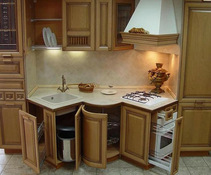 Is this a great use of space in the kitchen or what! check out the angles that the sink and stove are set on to make them fit into a smaller space!