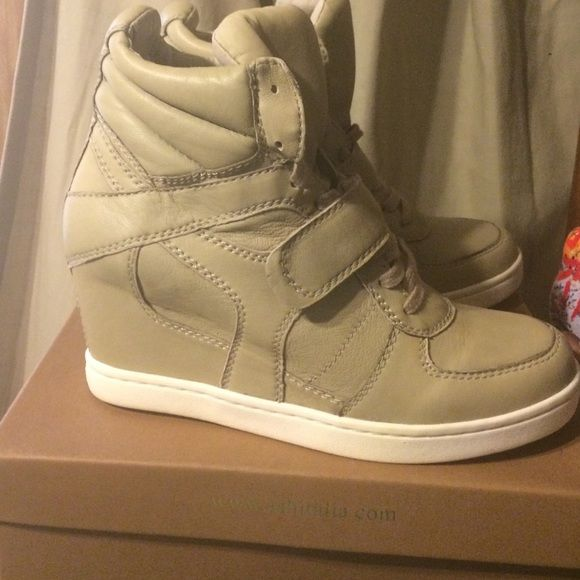 Ash Sneaker Wedges Taupe sneaker wedges. Heel height is about 3 inches. Never worn. Size 11 but fits like a size 10. Upper sole made of leather. Comes with original box. Ash Shoes Sneakers