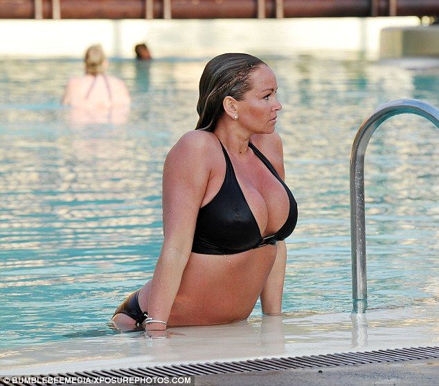 Me-time: The actress leaned out of the pool as the sun shone on her face