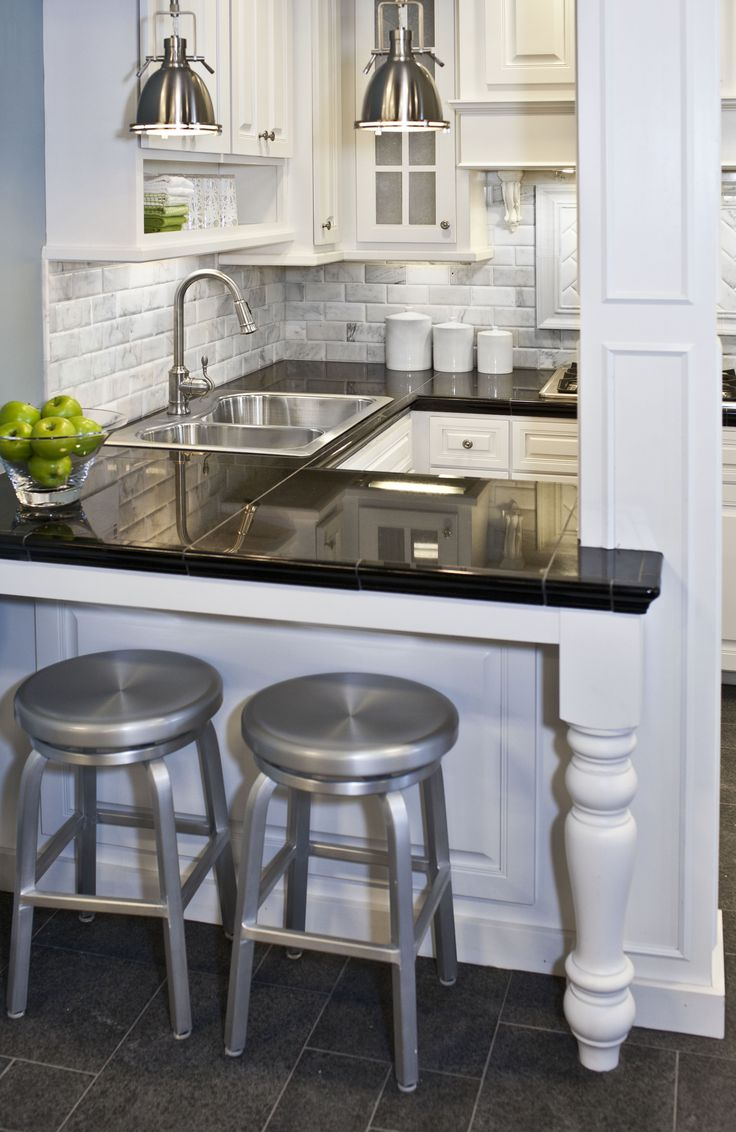 You can't go wrong with a classic black and white kitchen #thetileshop