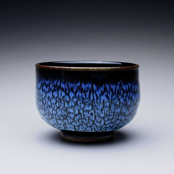 Chawan tea bowl. This handmade matcha chawan pottery bowl is glazed with a blue chun over a black tenmoku. Together these glazes produce a unique flowing pattern