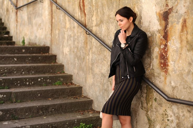 A leather jacket and a pencil skirt for a casual daytime look