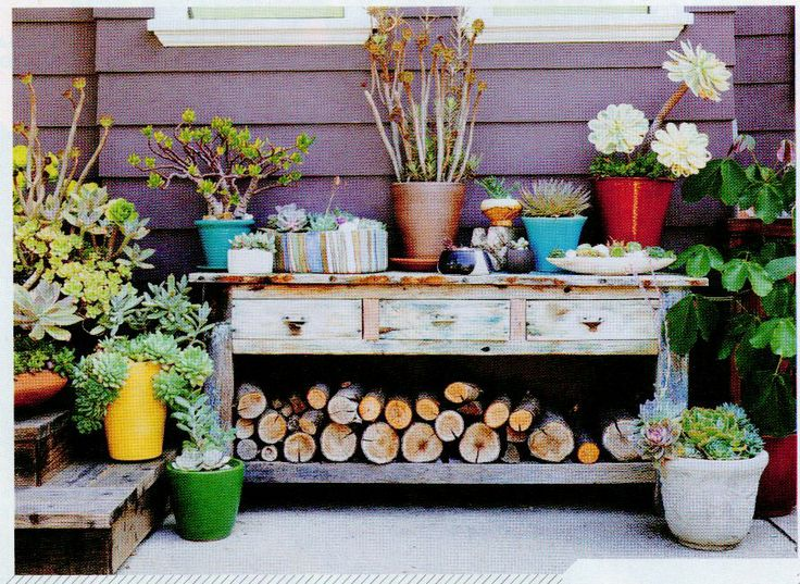 casual potting area and worn furniture. makes for a nice visual with the interesting and eclectic combination of pots. and firewood storage below! #sunsetmag