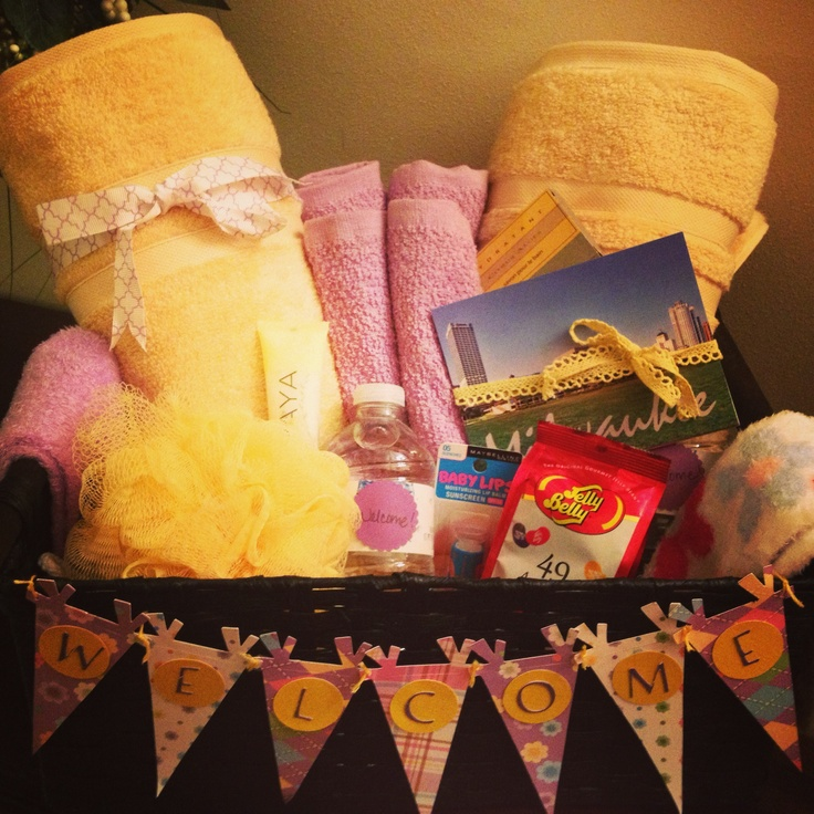 Guest room welcome basket for a foreign exchange student. Towels, soap, candy, water, socks, baby lips, lotion and postcards of where we will visit.