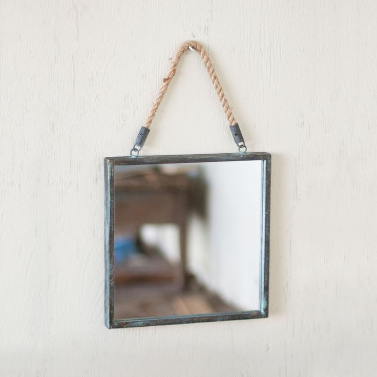 It's cool to be square these days. With its metal frame and rope hanger, this industrial-chic mirror can be hung in any room in your beach-friendly home.  Find the Beach Den Wall Mirror, as seen in the Decor Clearance Collection at http://dotandbo.com/collections/end-of-summer-sale-decor-clearance?utm_source=pinterest&utm_medium=organic&db_sku=KLL0380