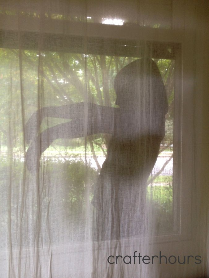 really really creepy halloween decoration get some black thin cloth and cut out a creepy girl shape and tape it to your window behind a see through