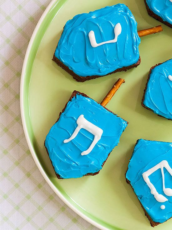 Happy Holiday Brownies: Celebrate the season using this easy technique for dressing up a batch of brownies. Cut a pan of your favorite brownies into dreidel shapes, then spread the treats with colored frosting and white hard-drying icing. Hanukkah For Kids, Hanukkah Crafts, Hanukkah Food, Christmas Hanukkah, Hannukah, Happy Hanukkah, Hanukkah 2019, Hanukkah Recipes, Hanukkah Decorations