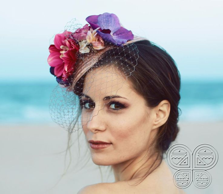 The Alicia Headpiece available at www.catavassalo.com 58€ is made over a straw beret with colorful flowers and a light pink veil, the ideal headpiece for a weeding reception in the sun!