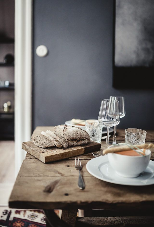 Rustic table in a dramatic Stockholm space in dark colours. 1 Street.