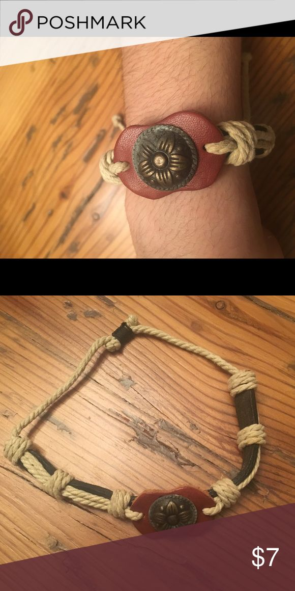 Rope Bracelet from Cape Cod New! Only worn for the picture. I was given this as a gift but it isn't my style. Very comfy and can be adjusted to any size wrist. Hand made and real leather. This is from Cape Cod. Made in Cape Cod Jewelry Bracelets