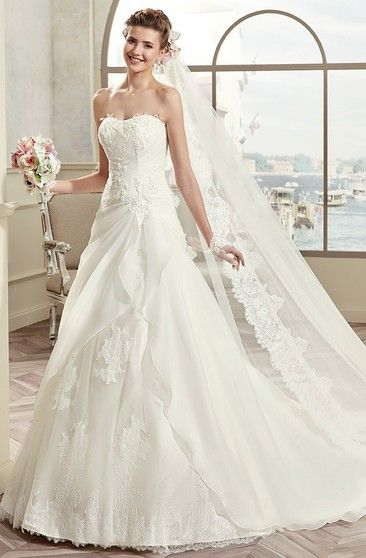 Strapless long lace wedding dress with asymmetrical ruffles and lace-up back