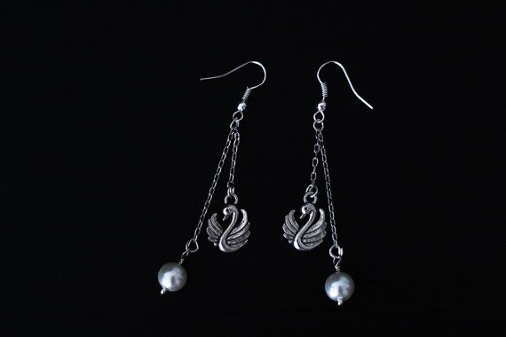Handmade, one of a kind dangle earrings with white beads and bird charms.