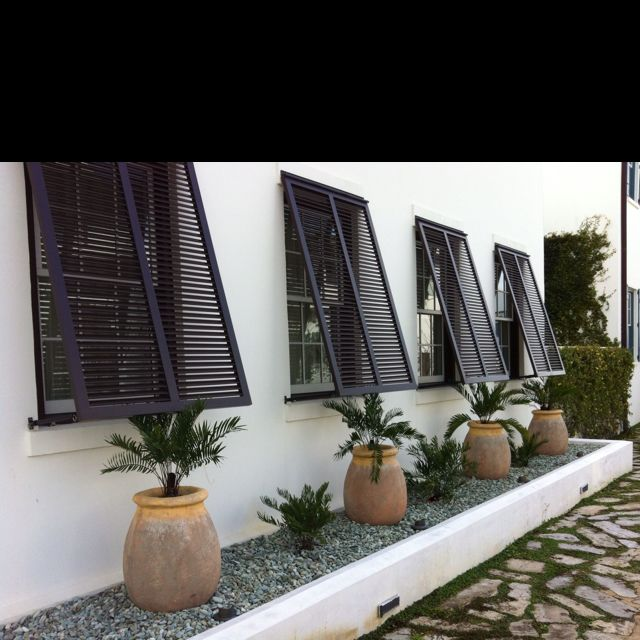 Shutters that she can leave closed. for privacy, shade, and security.