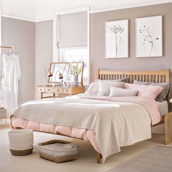 Bedroom with pale pink paint palette and wooden furniture