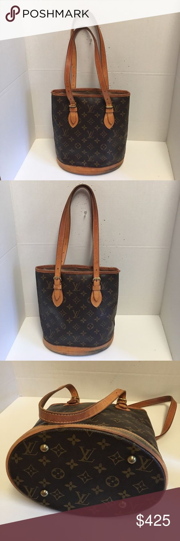 Authentic Louis Vuitton p.m. abucket bag Authentic Louis Vuitton p.m. bucket bag. Good condition. Does have some discoloration and aging on the bottom leather trim. Straps are in good condition. To zipper compartment inside. Louis Vuitton Bags Totes