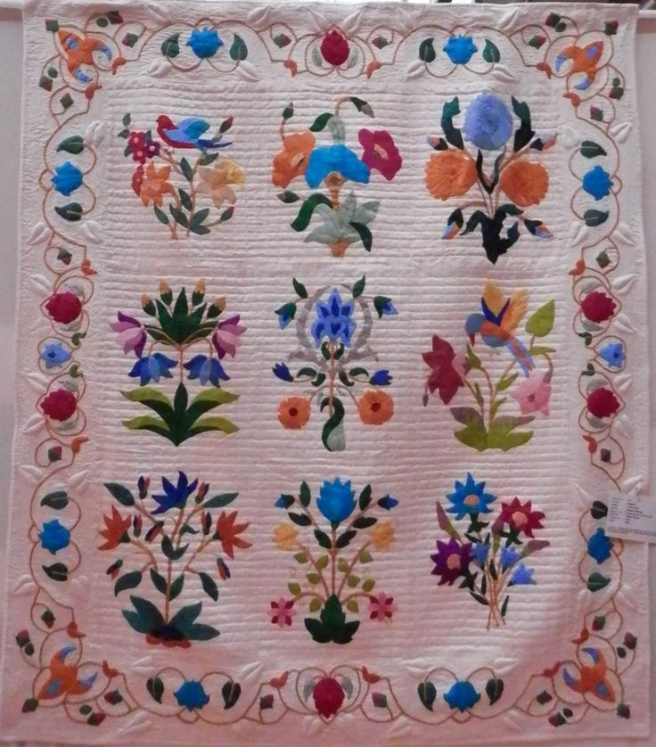 'Rajastan' by Heather Wheeler was completely made of silks that she bought on her travels to India.  The appliqué and quilting was even done with threads from the silks!