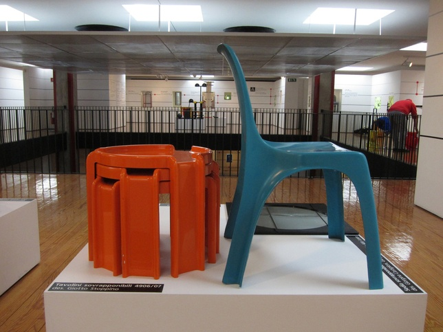 kartell museo orange stacking tables blue chair