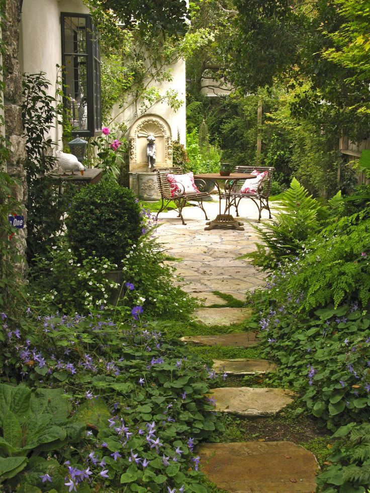 Moss Covered Paths Lined With Flowering Ground Cover, Ferns, And Hosta.  This Landscaped Courtyard Has Room For Patio Furniture And A Fountain.