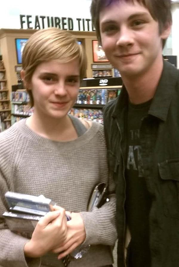 Emma Watson AND Logan Lerman (who is wearing a Beatles shirt, I see...) at a bookstore. This much amazing in one picture should be against the law.