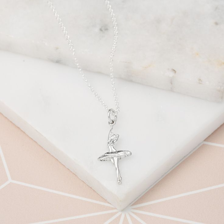 A gorgeous sterling silver ballerina necklace cast in a graceful and elegant pose en pointe. Perfect for anyone who loves ballet or a budding ballerina. #loveballet #stockingfiller