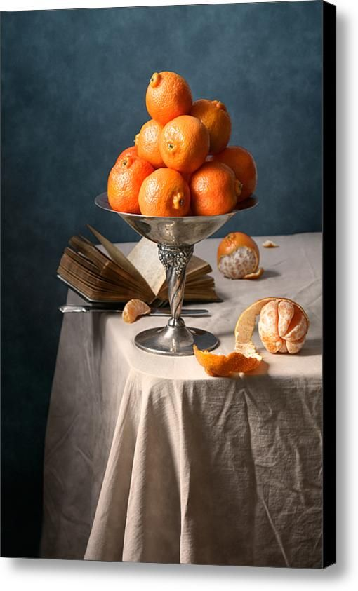 $74.96 Canvas Print: http://nikolay-panov.artistwebsites.com/products/clementines-nikolay-panov-canvas-print.html Fruit still life with many fresh clementines in metal vintage vase and old open book lying on table on deep blue background
