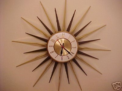 my mom had a similar looking clock in the kitchen when we were little  My moms favorite clock!