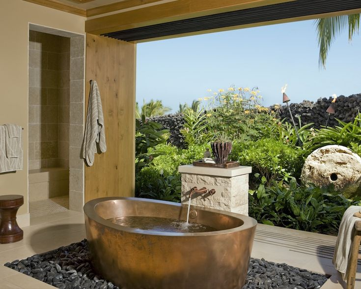 The glass walls of this exotic bathroom, bring the mesmerizing garden into the soaking tub area. ➤To see more Luxury Bathroom ideas visit us at www.luxurybathrooms.eu #luxurybathrooms #homedecorideas #bathroomideas @BathroomsLuxury