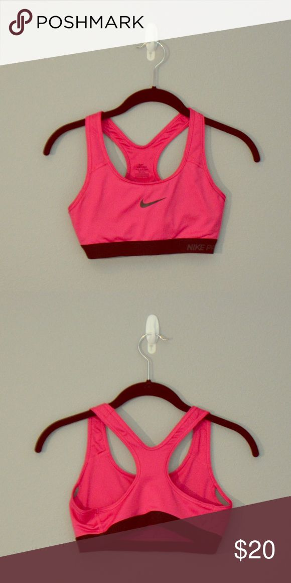 NIKE HOT PINK SPORTS BRA Never worn Pro Dri-FIT Nike sports bra! I bought it a few months ago without trying it on and discovered that it's too tight around my bust (no padding) Nike Intimates & Sleepwear Bras