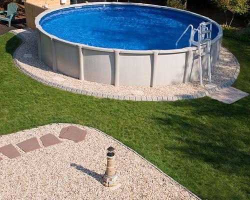 Use stone edge decorative edging around your pool for Above ground pool border ideas