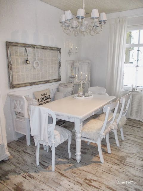 This warm white dining room in Germany mixes Scandanavian and French sensibilites.