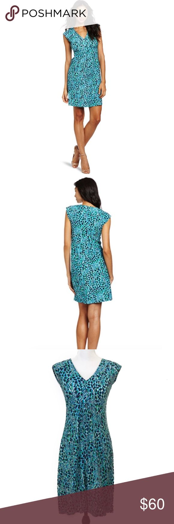 """Lilly Pulitzer Cyan Blue Gigi Print Garnet Dress Slubby cotton makes this dress the perfect transitional piece. Short Sleeve Printed V-Neck Dress. 100% Cotton. Blue and green giraffe print with """"hidden"""" giraffes throughout.  *All measurements are approximate*  Length: 35.5"""" Bust: 16"""" laying flat Waist: 14"""" laying flat Lilly Pulitzer Dresses"""