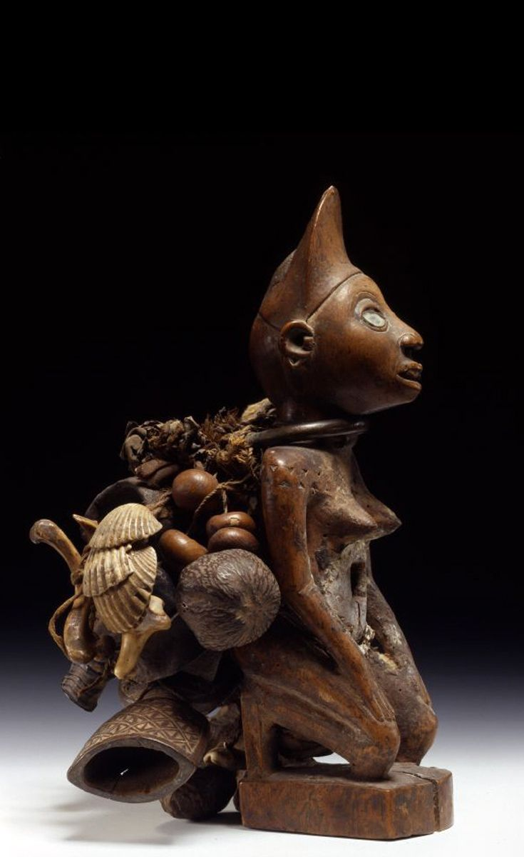 Africa | Female power figure from the region of the Democratic Republic of Congo | Wood, brass, iron, leather, plant fiber and glass | ca. 19th century |