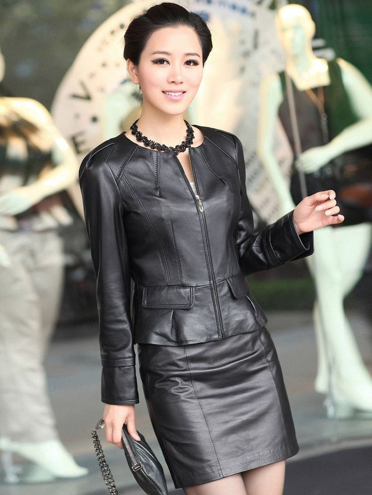 Asian girl in black leather skirt and jacket ensemble