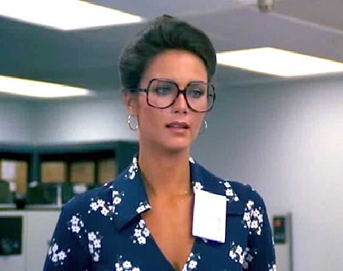 '70's:  Soft feminine hair, hoop earrings, and a good gloss.  Nix the ginormous glasses.  Unfortunately, the good genes (and recessive blue eyes) went to Lynda Carter.