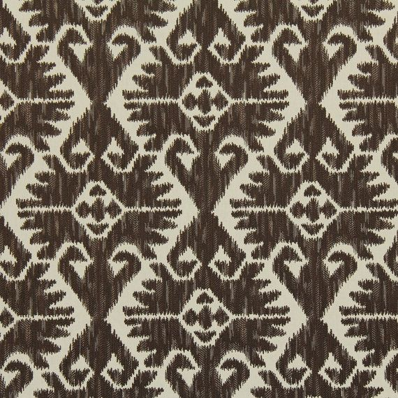 A traditional ikat upholstery fabric in chocolate brown and ivory. This mid-weight fabric is suitable for living room furniture, benches, and