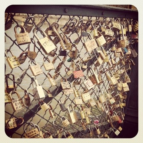 lovers bridge in Paris!! I wanna go!! You write you and your significant others name on a lock..lock it on this bridge then toss the key into the water!! Symbolizing being in love forever!!