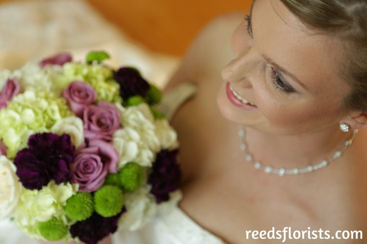 Beautiful bride and her bouquet designed by our experienced bridal desginers. reedsflorists.com