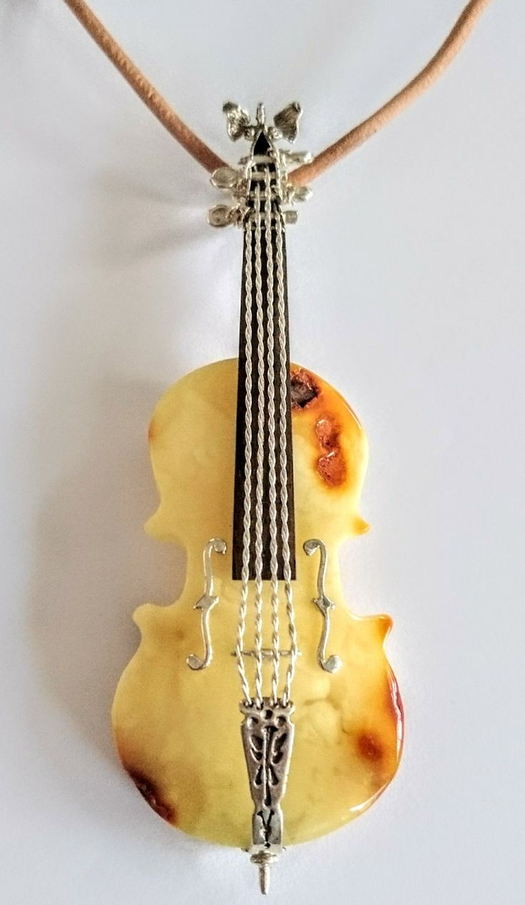 Pendant cello with Baltic amber