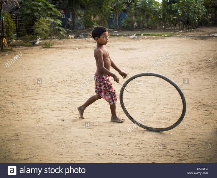Sittwe, Rakhine, Myanmar. 5th Nov, 2014. A Rohingya Muslim boy plays Stock Photo, Royalty Free Image: 75295792 - Alamy
