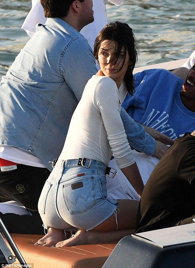 Everything's peachy: The billboard beauty flashed her pert posterior in a pair of Wrangler...