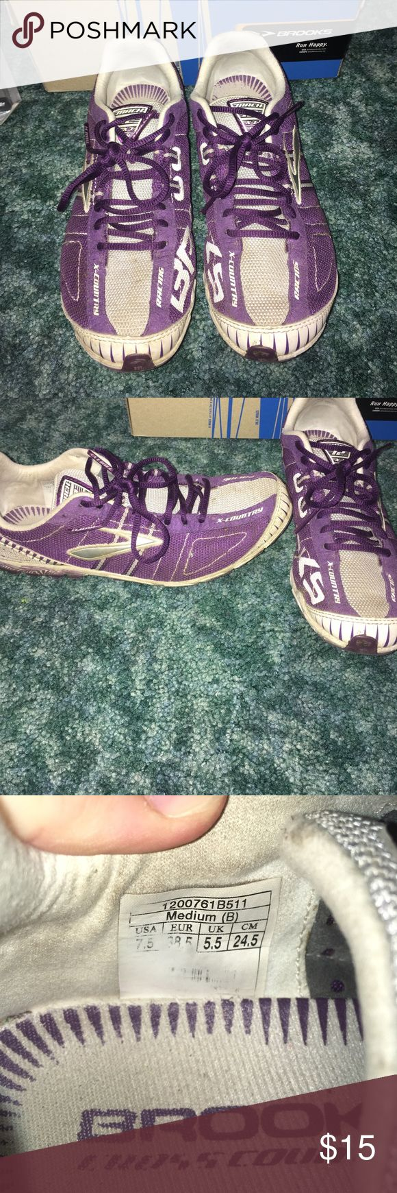 Brooks Track Shoes These are Brooks purple track shoes. They still have the metal spikes that came with them and extras. I only used them for half a season in middle school track. Size: 7.5 Still in amazing condition and the bottoms aren't even worn out. Still in original box. Brooks Shoes Athletic Shoes
