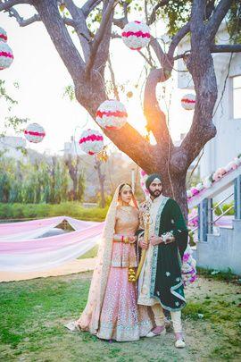 Candid Couple Shot - Japji & Birdi | WedMeGood | Bride in a Peplum Pink Blouse Lehenga with the Groom in a Beige and Gold Sherwani and  Velvet Safa  #wedmegood #indianbride #indiangroom #velvet #pink #lehenga #bridal #candidcoupleshot #coupleshot