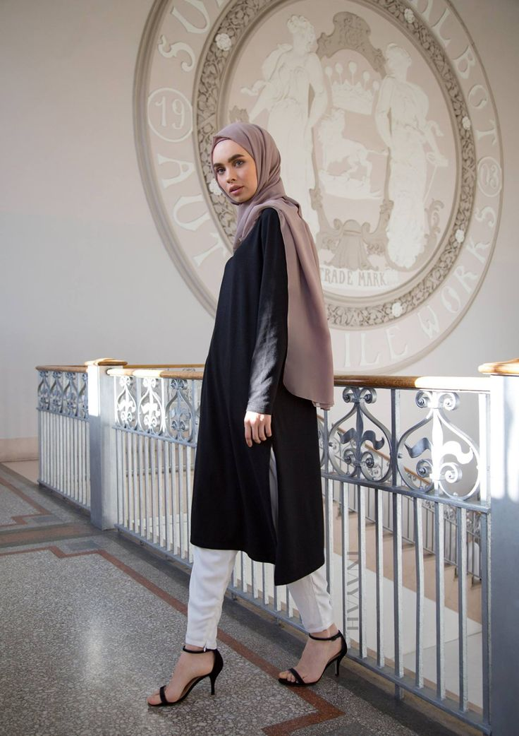 Minimal cuts and modest styling in monochrome hues with a pop of colour -   Black Asymmetric #Midi With Slits + White Tapered #Trousers + Light Flint Crepe #Hijab -  wwww.inayah.co