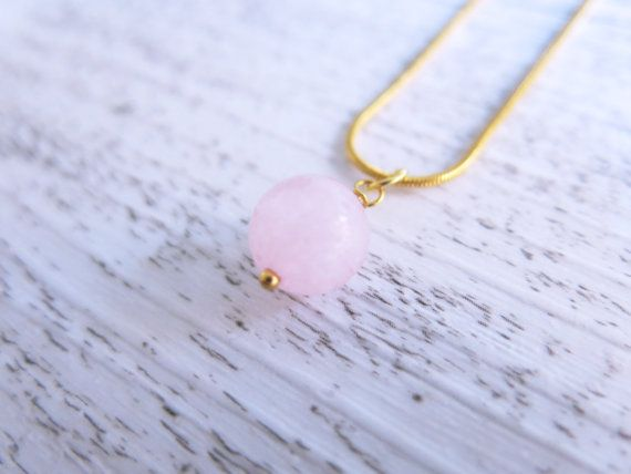This beautiful necklace is made from a stunning sphere of rose quartz suspended from a 24k gold plated chain.  Rose quartz is often called the
