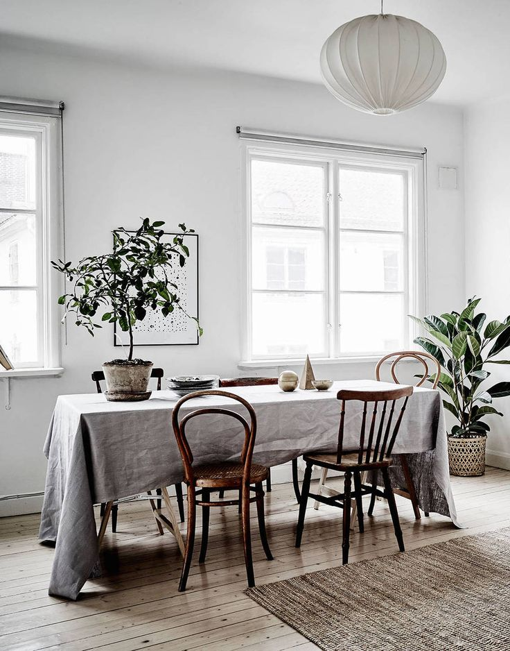 Linens on table with mismatched wood chairs. Beautiful casual dining room