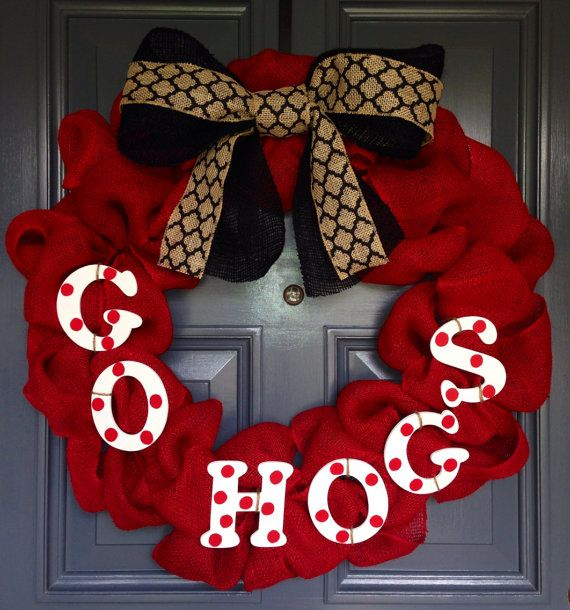 Here is a fun Razorback wreath made with red burlap and a double layer bow of black burlap ribbon and black/natural geometric ribbon. GO