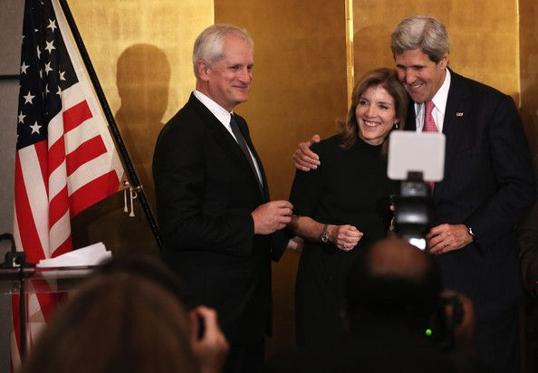 Caroline Kennedy Photos Photos - U.S. Secretary of State John Kerry (R) shares a moment with U.S. Ambassador Caroline Kennedy (2nd L) and her husband Ed Schlossberg (L) during a reception hosted by Japanese Ambassador to the U.S. Kenichiro Sasae at the ambassador's residence November 12, 2013 in Washington, DC. Kennedy was sworn in to be the new ambassador to Japan today at the State Department. - Reception Held for Caroline Kennedy