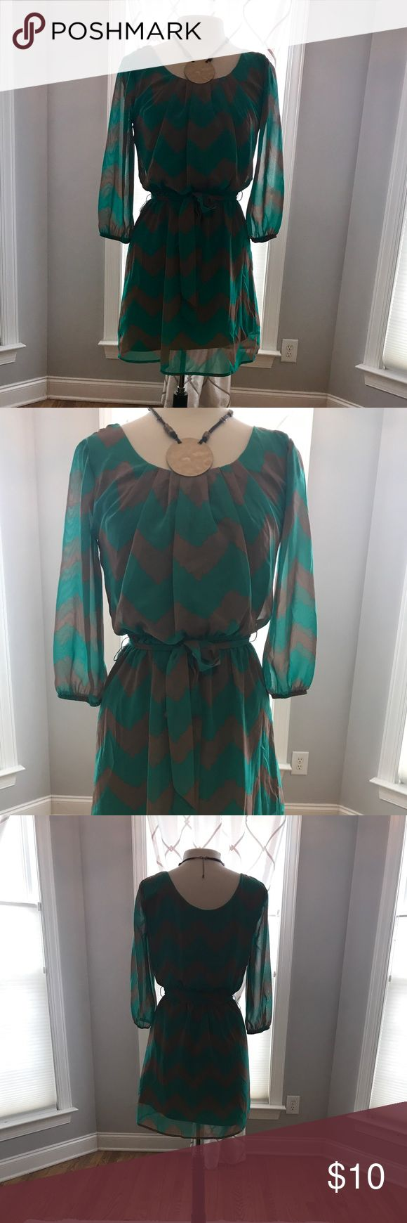 Chevron Print Dress by Lily Rose Super cute green and brown chevron print dress with tie at waist.   Sleeves are sheer.   Size small  Great preowned condition. All reasonable offers accepted. Bundle and save! Lily Rose Dresses
