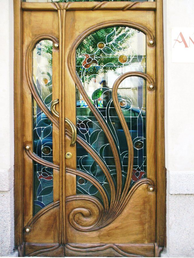 Art Nouveau stained glass and carved wood door, Astorga, León, España