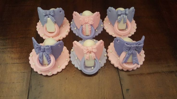 Baby shower pacifier cupcake toppers.